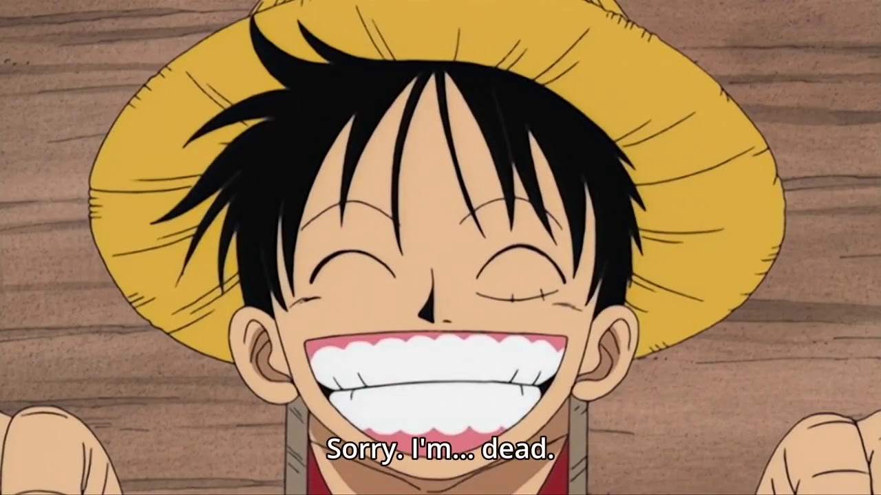 Luffy sonriendo antes de ser ejecutado